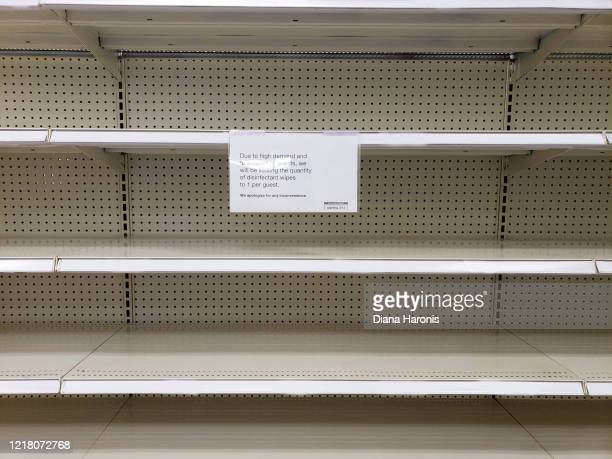sign on empty store shelf for disinfectant wipes - sold out stock pictures, royalty-free photos & images