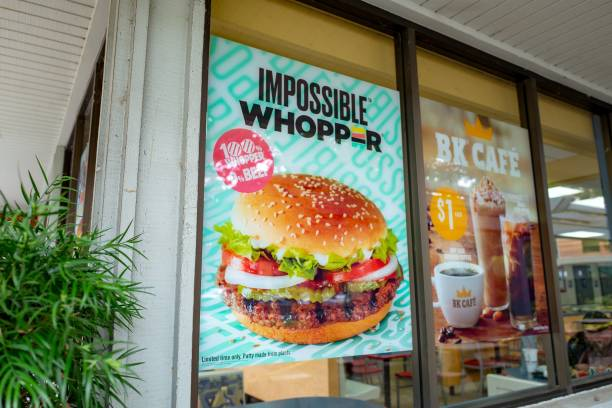 Sign on facade advertising Impossible Whopper, a meat-free item using engineered, plant-protein based burger patty from food technology company...