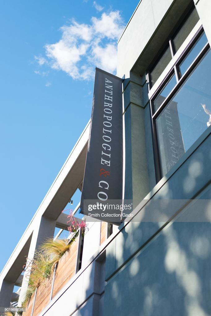 Sign on facade of Anthropologie and Co upscale home ...