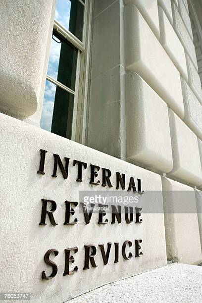 sign on internal revenue service building, washington, dc - irs stock photos and pictures