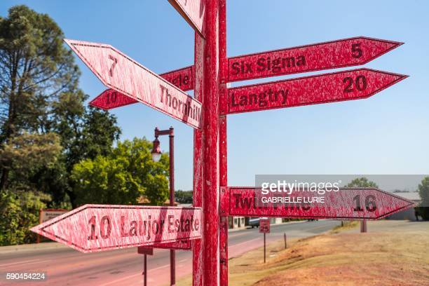 A sign on Main Street is covered in fire retardant after the Clayton Fire ravaged the downtown of Lower Lake California August 16 2016 A man was...