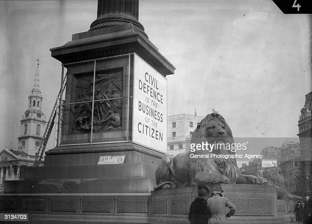 A sign on Nelson's Column in London's Trafalgar Square reading 'Civil Defence is the Business of the Citizen'