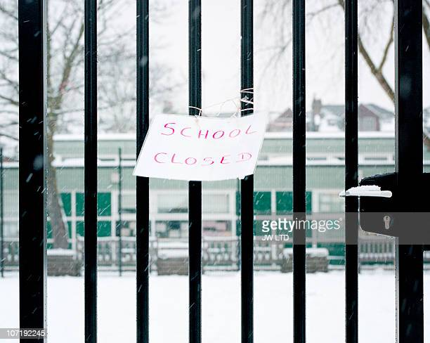 Sign on railings saying school closed