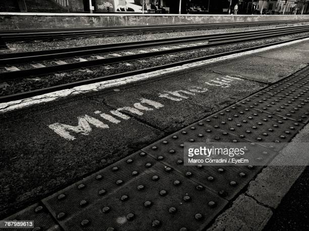 sign on railroad station platform - weybridge stock photos and pictures