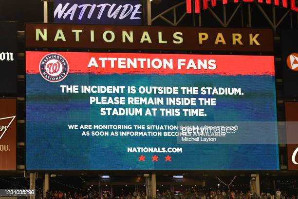 Sign on scoreboard after what is believed to be shots were heard outside the stadium during a baseball game between the San Diego Padres and the...