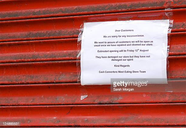 Sign on shop window'They have damaged our store but they have not damaged our spirit'