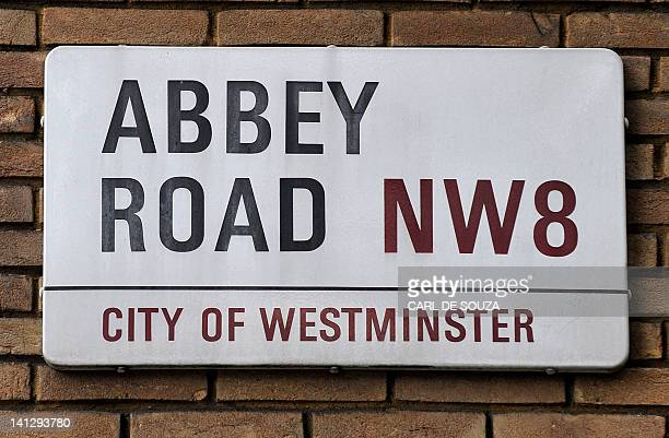 A sign on the Abbey Road is pictured in north London on August 7 2009 Fans of the Fab Four are flocking to the most famous crosswalk in Britain for...