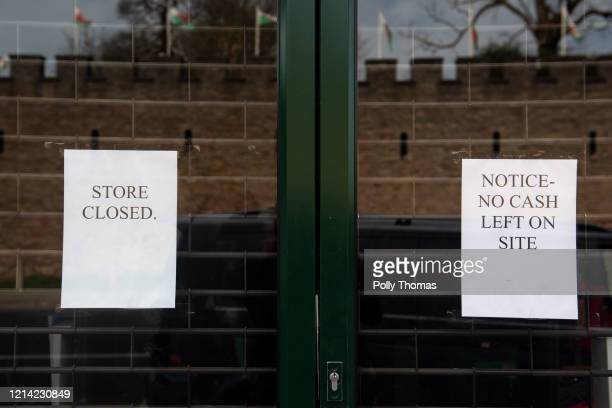 A sign on the door of a Mountain Warehouse shop informing that the store is closed on March 23 2020 in Cardiff United Kingdom Coronavirus pandemic...