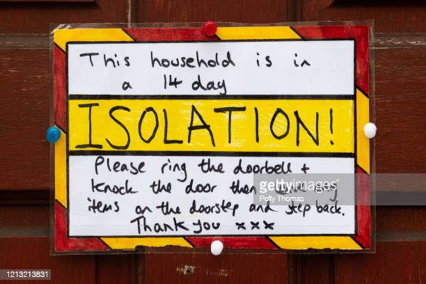 A sign on the door of a residential property where the household are in a 14 day isolation in accordance with new government guidelines on March 18...