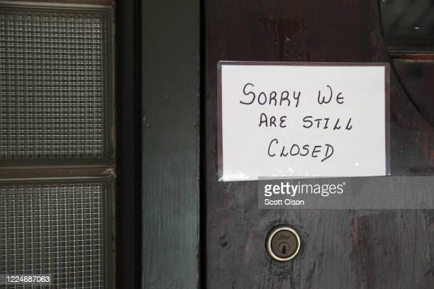 Sign on the door of Flannery's Tavern lets customers know the business is still closed on May 13, 2020 in Chesterton, Indiana. Recently, Indiana...