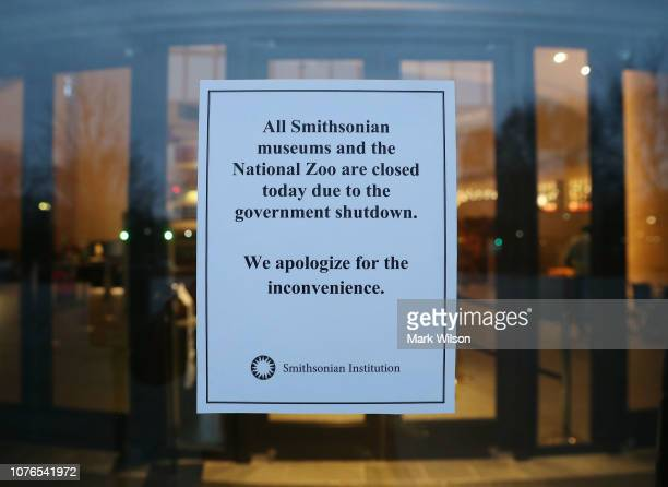 A sign on the door of The National Museum of the American Indian states that the museum is closed as the partial shutdown of the US government goes...