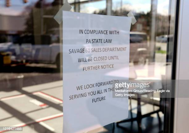A sign on the door that reads In compliance with PA State Law Savage 61 Sales Department will be closed until further notice We look forward to...