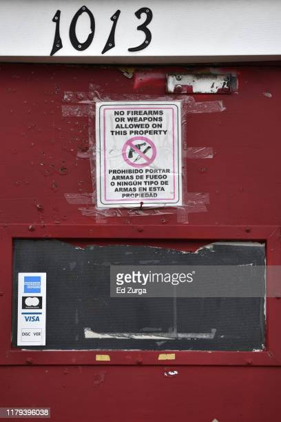 A sign on the door to Tequila KC bar prohibits firearms or weapons is posted on the door were 9 people were shot and four killed on October 06 2019...