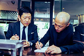 businessman meeting with restaurant owner his