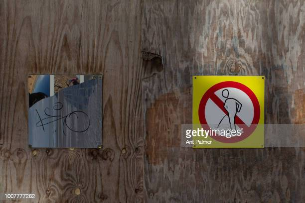 A sign on the fence of a building site prohibiting public urination on July 23 2018 in Ostend Belgium