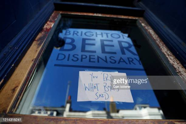 A sign on the front door of the Brighton Beer Dispensary displaying the message 'You 'erd what Boris said' informs customers that the pub has closed...