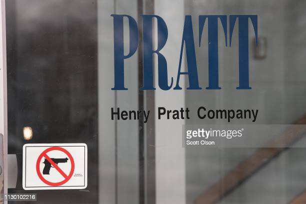 A sign on the front door of the Henry Pratt Company office shows that guns are not allowed in the building on February 16 2019 in Aurora Illinois...