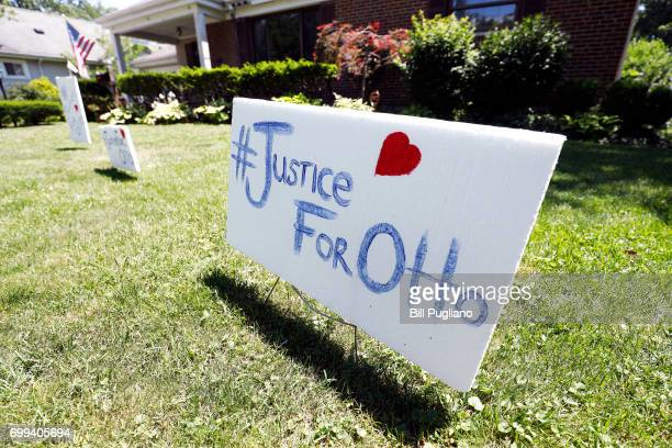 A sign on the front lawn of Lauren Wadds Wyoming Ohio home proclaims '#Justice For Otto' as the the town of Wyoming prepares for the funeral of Otto...