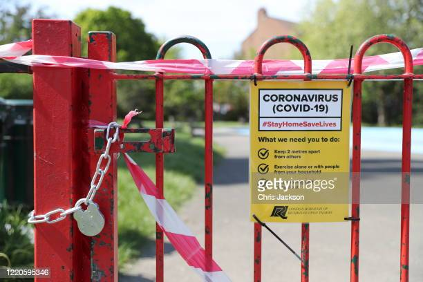 A sign on the gate of a closed children's playground in Barnes on April 23 2020 in London England The British government has extended the lockdown...
