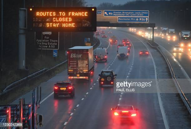 Sign on the M56 motorway informs drivers that all routes into France are closed at the junction with the M6 at Lower Stretton near Warrington,...