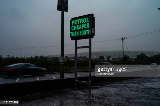 Sign on the Northern Irish side of the River Finn, advertising cheaper petrol than that on the Irish Side, on August 30, 2019 in Strabane, Northern...