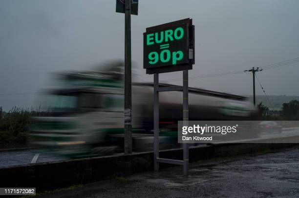 Sign on the Northern Irish side of the River Finn, advertising the Euro to Pound Stirling conversion on August 30, 2019 in Strabane, Northern...