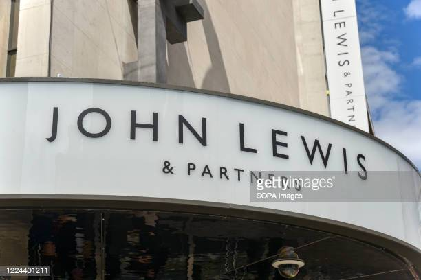 Sign on the Oxford Street branch of John Lewis, as the Partnership is poised to: cut jobs, axe the annual bonus, close one of its London headquarters...