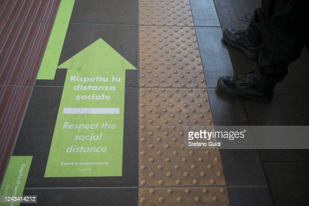 A sign on the platform's floor to remind travelers of respecting social distance at the Porta Nuova railway station on June 03 2020 in Turin Italy...