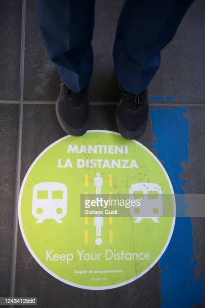 A sign on the platform's floor to remind travelers of social distance at the Porta Nuova railway station on June 03 2020 in Turin Italy Today 3 June...