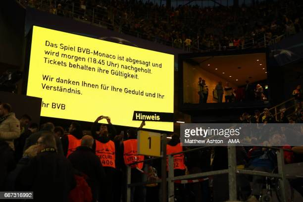 A sign on the stadium scoreboard alerting fans that the match has been postponed and will be played tomorrow at 1845h at the UEFA Champions League...