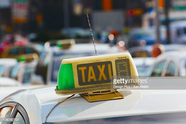 sign on top of a taxi