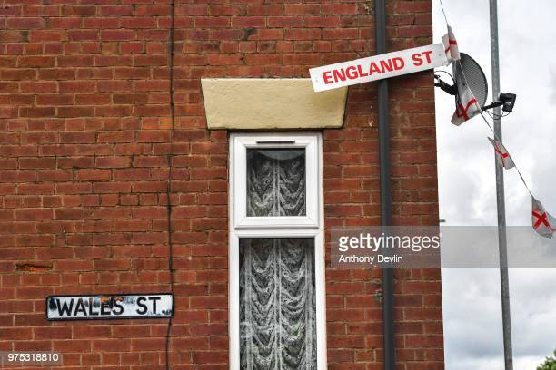 A sign on Wales Street in Oldham which local residents have renamed England Street and decorated with flags to celebrate the FIFA World Cup Russia...