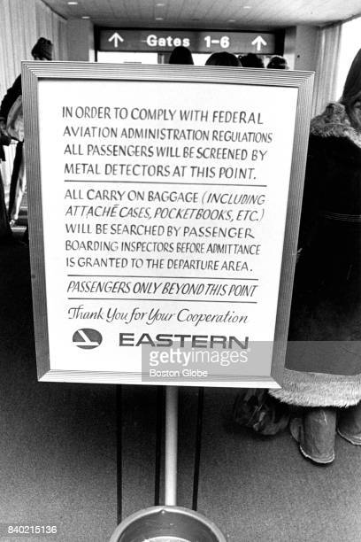A sign outlining security procedures is pictured at the Eastern Air Lines terminal at Logan Airport in Boston on Jan 6 1973