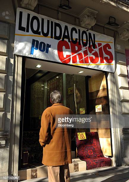 A sign outside a carpet store reads 'Closing down due to the crisis' at Calle Serrano in Madrid Spain on Thursday Nov 25 2010 The number of...