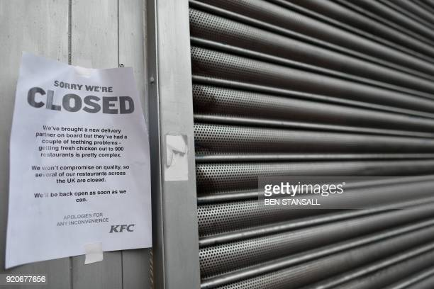 A sign outside a closed KFC fast food store in south London is closed on February 19 2018 explains the closure is due to a shortage of fresh chicken...