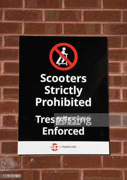 A sign outside a parking garage in Nashville Tennessee declares that electric or batterypowered scooters are prohibited