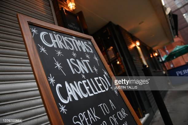 Sign outside a pub advertises a Christmas venue in London on October 21 as the government considers further lockdown measures to combat the rise in...
