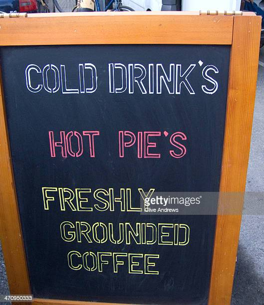 CONTENT] A sign outside a shop selling drinks pies and coffee There are incorrect apostrophes in the words 'drinks' and 'pies' and the word...