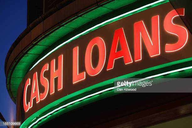 Sign outside a 'Speedy Cash' cash loans shop on Brixton High Street on November 1, 2012 in London, England. The recession has changed the face of the...