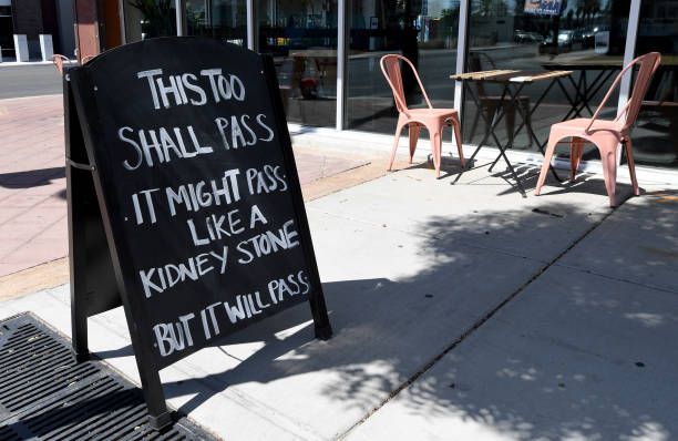 A sign outside a Tacotarian restaurant displays a humorous message amid the spread the coronavirus on May 20 2020 in Las Vegas Nevada Some businesses...