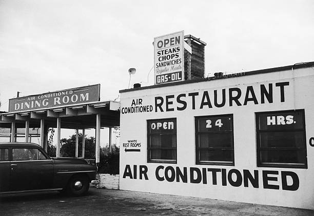 A sign outside an American restaurant points to the...