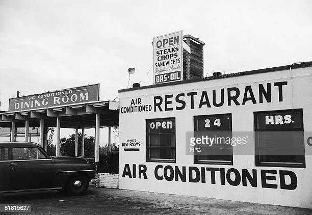 Sign outside an American restaurant points to the 'White Rest Rooms', in a clear indication of racial segregation, circa 1960.