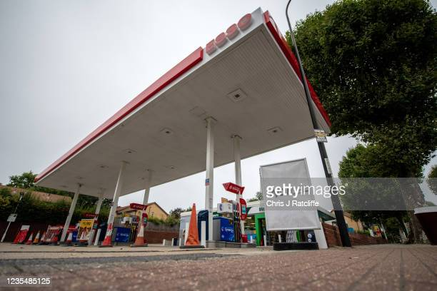 Sign outside an Esso garage informing the public that they have no fuel on September 25, 2021 in Catford, London, United Kingdom. BP and Esso have...