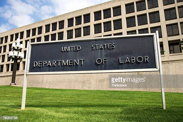 sign outside department of labor building, washington, dc - thinkstock foto e immagini stock