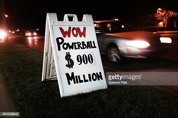 A sign outside of a Connecticut gas station displays the current winnings in the Powerball lottery on January 9 2016 in Westport ConnecticutThe $900...