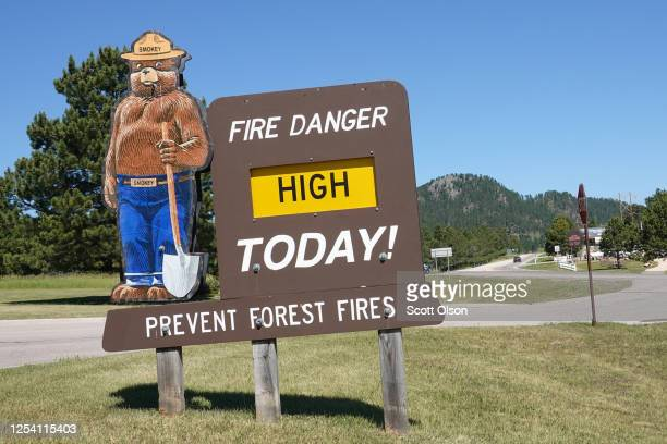 Sign outside of a ranger station describes the fire danger as high in the Black Hills near Mount Rushmore National Monument on July 03, 2020 in...