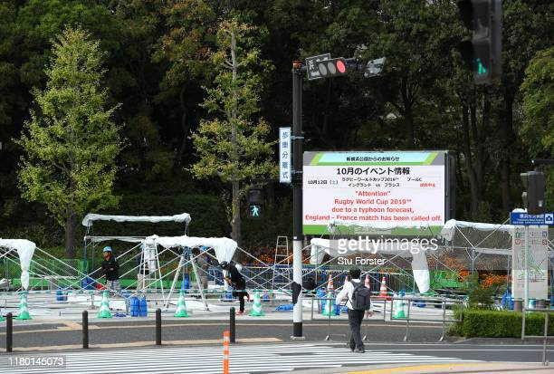 A sign outside of the Yokohama Stadium informs of the cancellation of the England v France game due to Typhoon Hagibis forecast for saturday as...