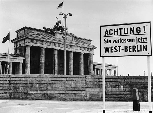 A sign outside the Brandenburg Gate and the Berlin...