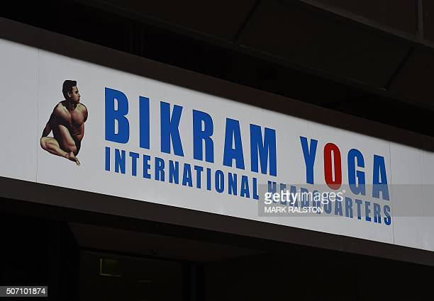 A sign outside the building housing the Worldwide headquarters of Bikram Yoga is seen in Santa Monica California on January 27 2016 Bikram Choudhury...