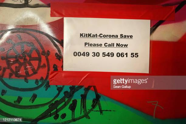 A sign outside the famed KitKat Club refers to the coronavirus on March 12 2020 in Berlin Germany City authorities are putting pressure on Berlin's...